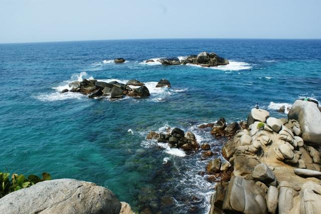 tayrona sitting on rocks sea
